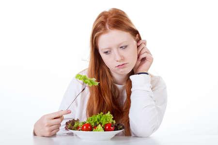 白い背景と分離食欲がない十代の少女 写真素材