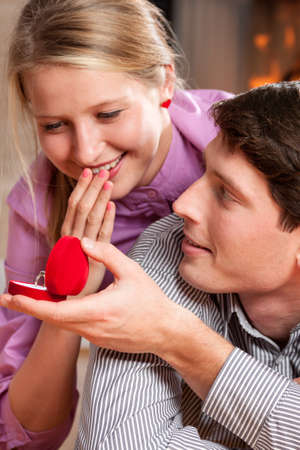 beloved: Young man giving beautiful ring to beloved woman