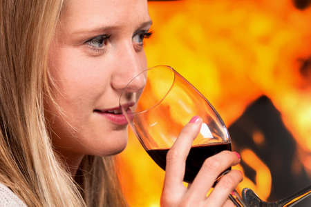 Close up of happy woman with glass of wine on her hand  photo