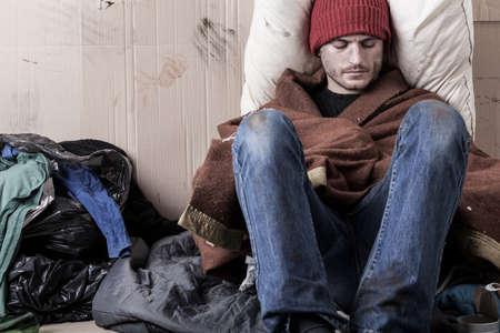 alcoholic man: Sad and poor man sitting on the street Stock Photo