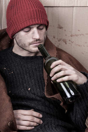 Homeless man addicted to alcohol on the street photo