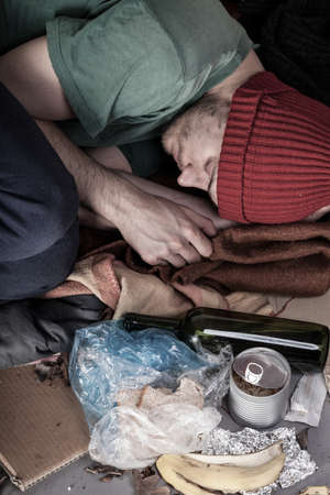 Homeless and alcoholic sleeping on the street photo