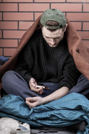 Homeless and poor man addicted to drugs