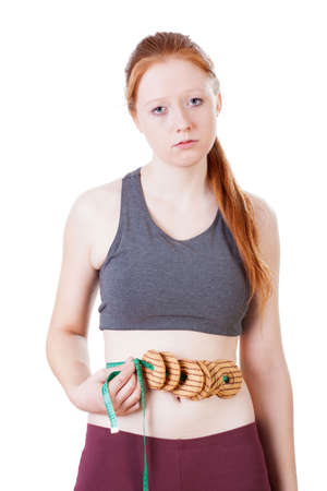 Young woman frustrated by results of her diet photo