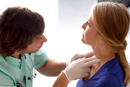 lymph: Doctor checking lymph nodes on patients neck