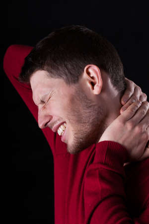 throe: Man with neck ache on isolated background