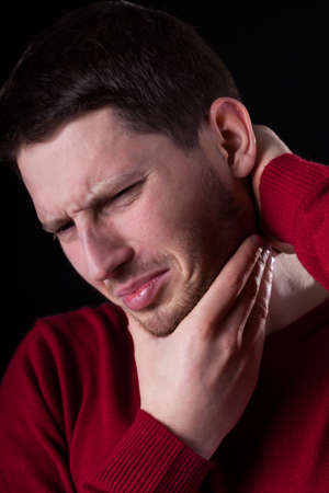 throe: Man having strong pain on isolated background Stock Photo
