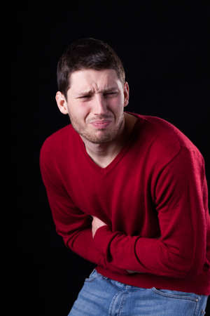diarrhoea: Vertical view of a man suffering from stomach ache Stock Photo