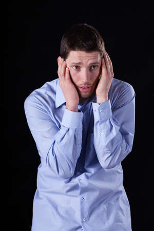 throe: Elegant man with headache on isolated background