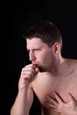 throe: Man suffering from cough on isolated background Stock Photo