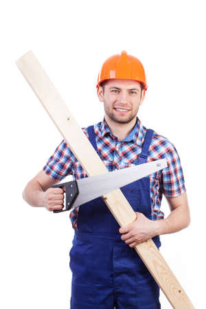 woodworker: Carpenter in helmet holding plank and saw, vertical