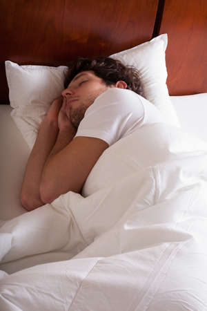Man sleeping in bed in the morning photo