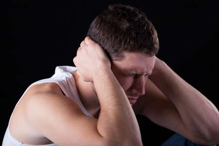 throe: Man feeling strong migraine on isolated background