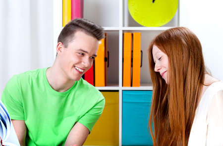 Happy female and male teenagers are learning photo