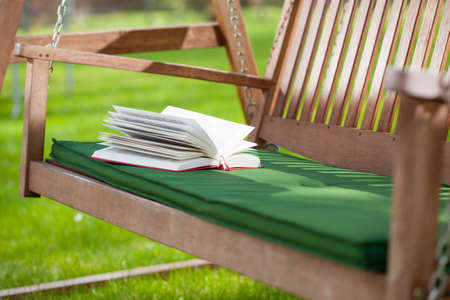 pleasure of reading: Horizontal view of a relax in a garden