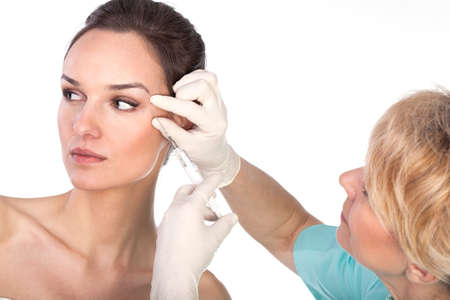 Close-up of young woman during botox therapy photo