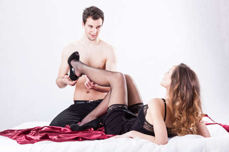 bed sex: Lovers in erotic situation on isolated background Stock Photo