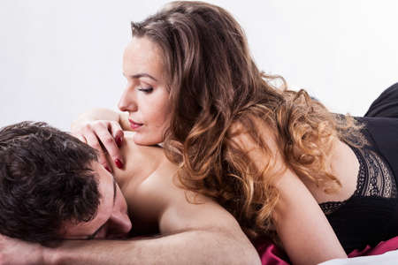 Erotic moments in bedroom on isolated background