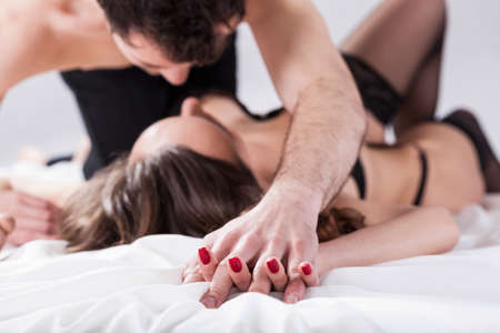 hot sex: Horizontal view of a sexual intercourse in bed
