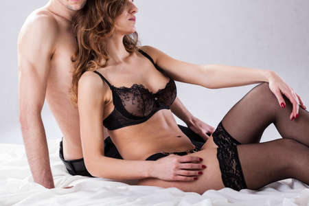 erotic couple: Lovers before sexual intercourse on isolated background Stock Photo
