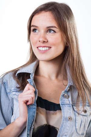 Portrait of a smiling teenage girl in denim jacket photo