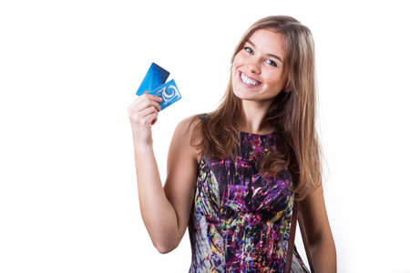 Cheerful young woman holding two credit cards