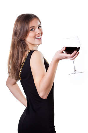 Beautiful girl in black dress holding a glass of red wine photo