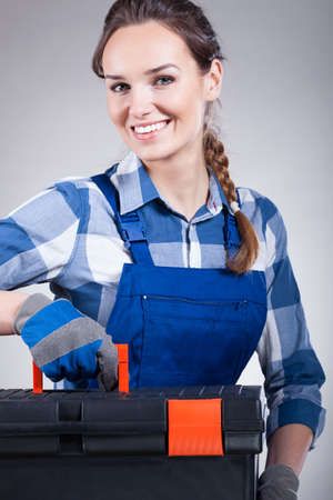 Handywoman with a toolbox ready to work photo