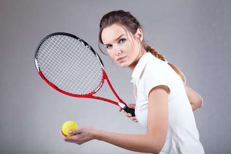 polo player: Focused woman playing tennis on isolated background Stock Photo