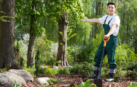 gardening gloves: Gardener in a beautiful green garden, horizontal Stock Photo