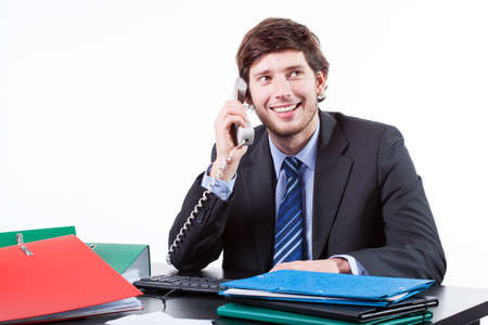 smilling: Smilling businessman talking on the phone  in office