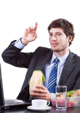 raises: Young Businessman eating and raises his hand