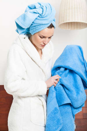 Beautiful young woman in dressing-gown during the morning bath photo