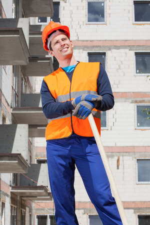 Builder keeping a spade at building area photo