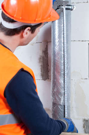 locating: Vertical view of an engineer locating a gutter Stock Photo