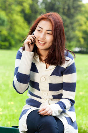 lady on phone: Mongolian lady talking on a phone, vertical Stock Photo