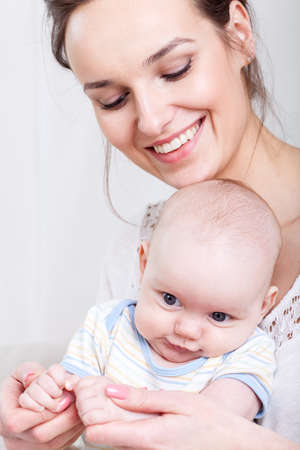 Little baby and happy mother on isolated  photo