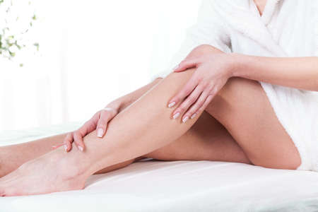 legs skin: Female legs after massage on isolated  Stock Photo