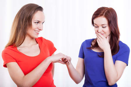 admiration: Pretty woman showing engagement ring to her friend Stock Photo