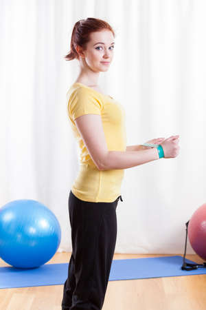 elastic band: Young woman exercising with a elastic band  Stock Photo