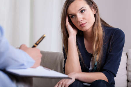 Woman during first meeting with psychotherapist, horizontal