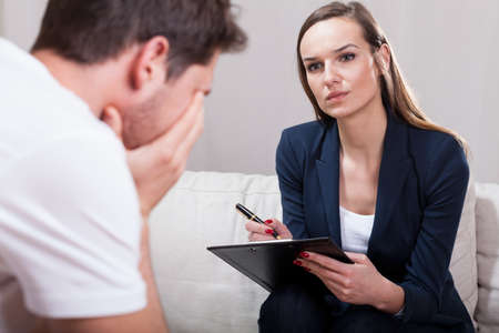 Horizontal view of a psychotherapist during work Stock Photo