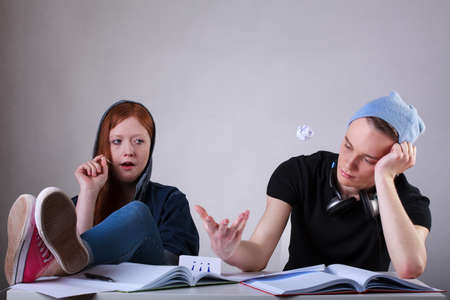 rebellion: Portrait of a bored teenage students in classroom