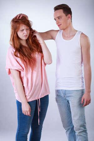 teasing: Teenage boy teasing her female colleague, vertical