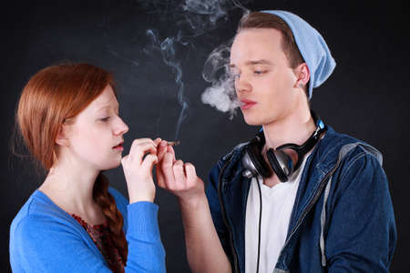 Horizontal view of a teenagers smoking marijuana joint  Stock Photo