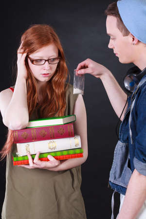 drug deals: Young dealer selling student girl bag with cocaine Stock Photo