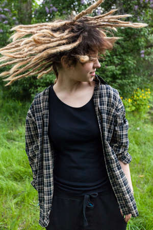 vandalize: Crazy young girl with dreadlocks on the outside