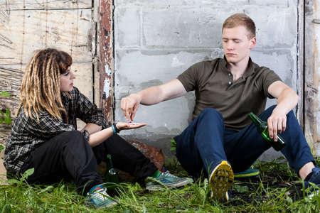 vandalize: Couple of friends during taking drugs, horizontal Stock Photo