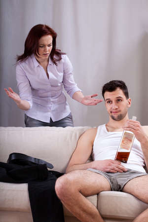 lazybones: Husband drinking whiskey and ignoring his talking wife