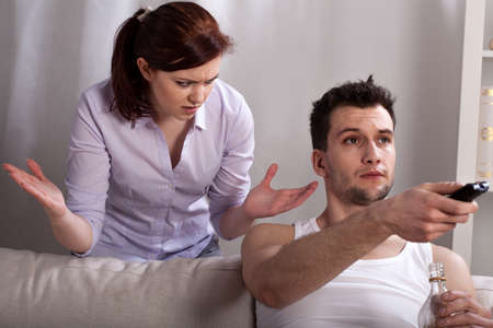 lazybones: The alcoholic problems in young marriage, horizontal Stock Photo